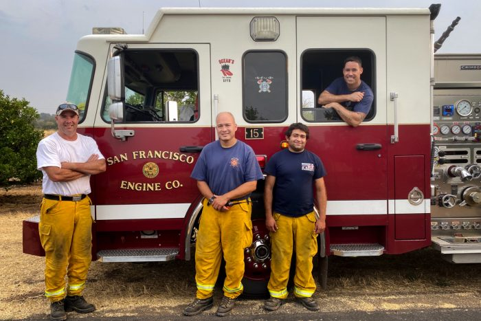 SFFD firefights in northern california pause for a photo between fires
