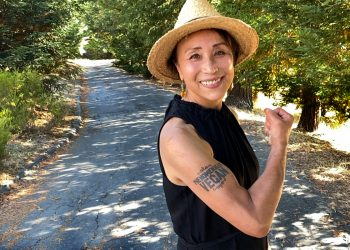 "Miyoko Schinner of Miyoko's Creamery poses with her ""powerfully vegan"" tattoo on her farm where she works to end animal cruelty"