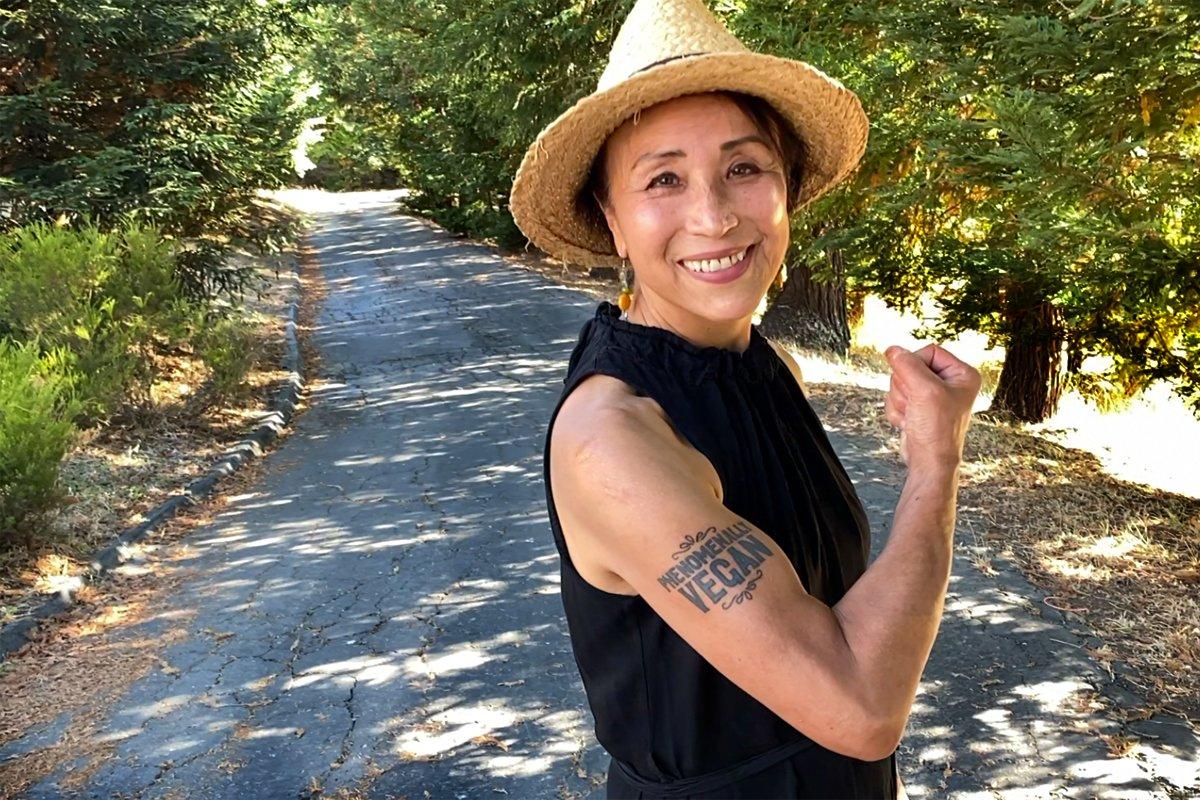 """Miyoko Schinner of Miyoko's Creamery poses with her """"powerfully vegan"""" tattoo on her farm where she works to end animal cruelty"""