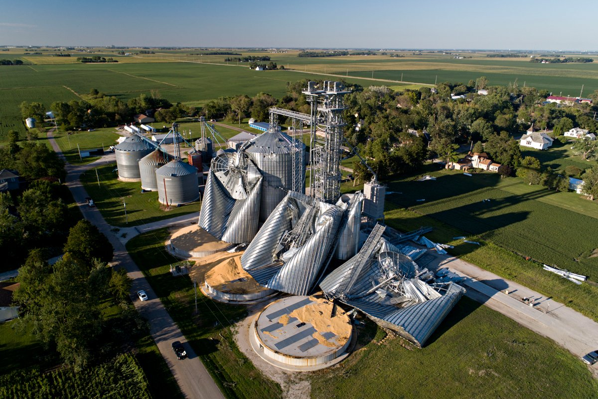 Grain bins damaged by the derecho storm in are shown at the Heartland Co-Op grain elevator on August 11, 2020 in Luther, Iowa.