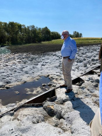 Agriculture Secretary Sonny Perdue surveys the new CREP wetland structure on the Stolee Farm. (Photo CC-licensed by the USDA)