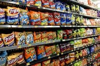 Dozens of kinds of potato chips, corn chips, and other ultra-processed foods in the supermarket. (Photo credit: Mike Mozart)