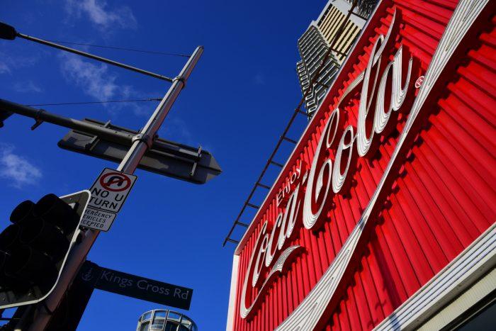 A gigantic billboard advertising Coca-Cola