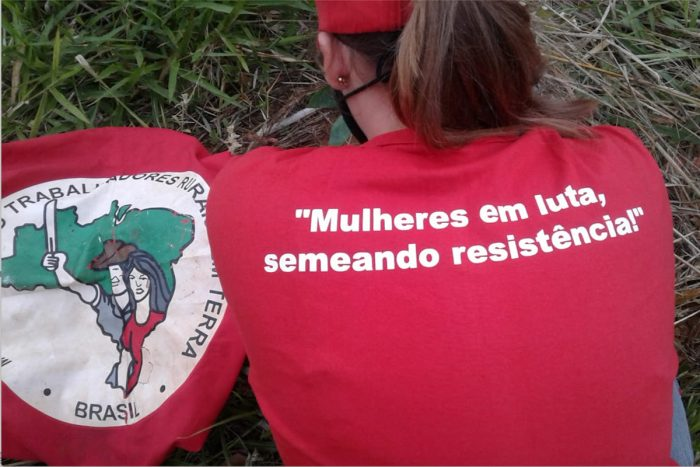 """A woman wears a t-shirt that reads """"Fighting women, planting resistance."""" (Photo by MST Paraná Archives)"""