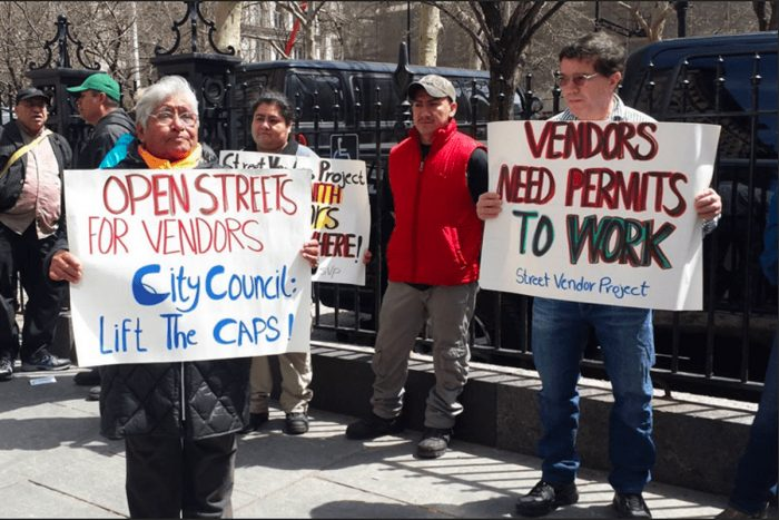 Street vendor Heleodora Flores at a protest in New York City. (Photo credit: Urban Justice Center)