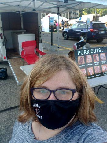 Natasha Paris wears a mask at her farmers' market.