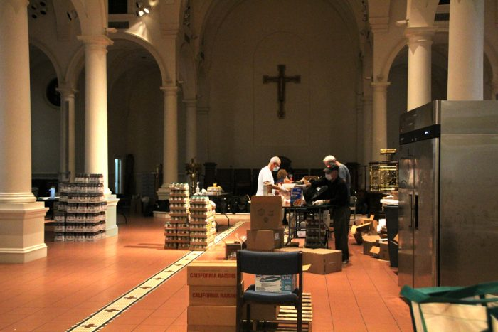 Preparing meal deliveries inside Holy Apostles. (Photo by Ada Cowan)