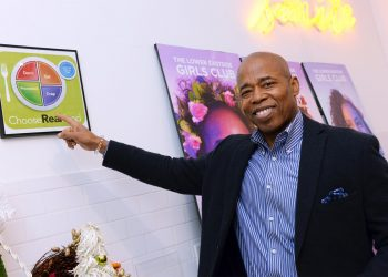 Brooklyn Borough President Eric Adams points to a healthy eating poster at the Lower East Side Girls Club. (Photo credit: Erica Sherman/Brooklyn BP's Office)
