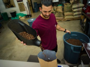 Bagging roasted coffee at O-Gah-Pah Coffee, a Native-owned business in the Quapaw Nation.