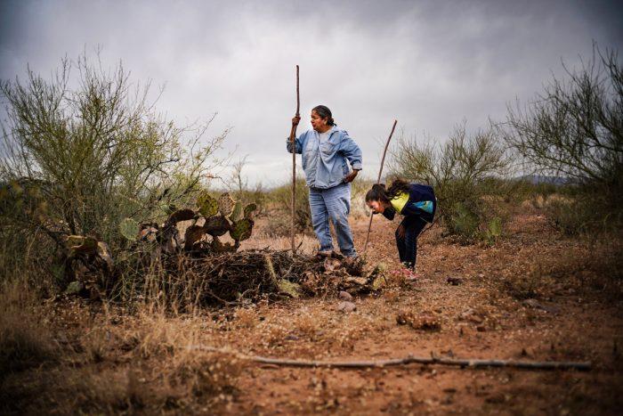 Twila Cassadora and her niece hunt rats in the Arizona desert. (Photo credit: Renan Ozturk)