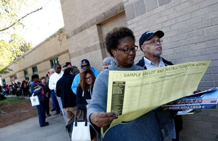 Voters line up at Charlotte Mecklenburg University City Library on October 24, 2016 in Charlotte, North Carolina. (Photo by Brian Blanco/Getty Images)