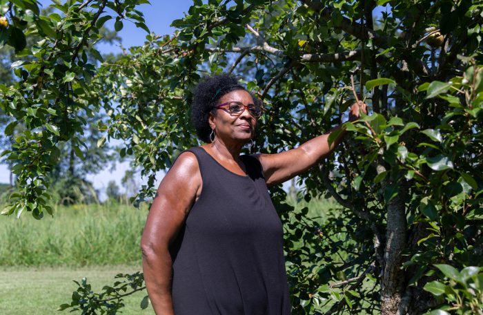 Eunice Hill in her garden outside her home on the Hill Family Farm in Edgecombe County, N.C. (Photo © Hanna Wondmagegn)