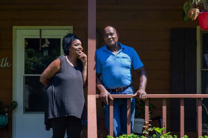 Eunice Hill and Sylvester Hill Sr. pose for a portrait on the porch of their family home at the Hill Family Farm in Edgecombe County, N.C. (Photo © Hanna Wondmagegn)