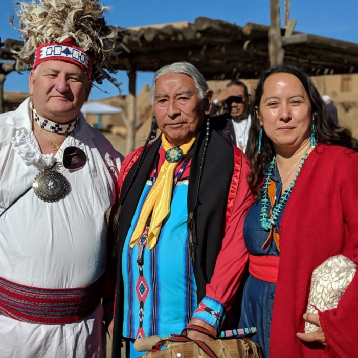 Rowen White stands with two tribal elders. (Photo courtesy of Rowen White)