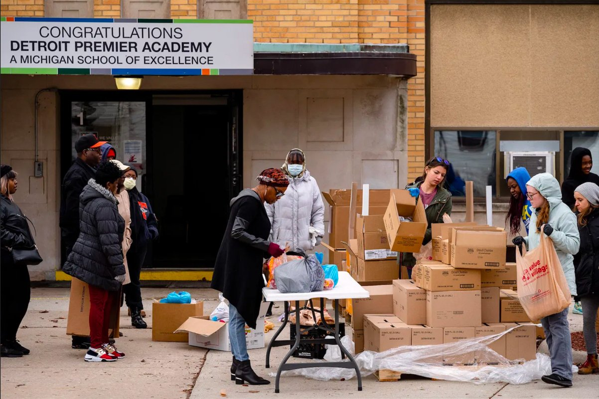 Gleaners workers distribute produce at Detroit Premier Academy this past March. (Photo credit: Nick Hagen)
