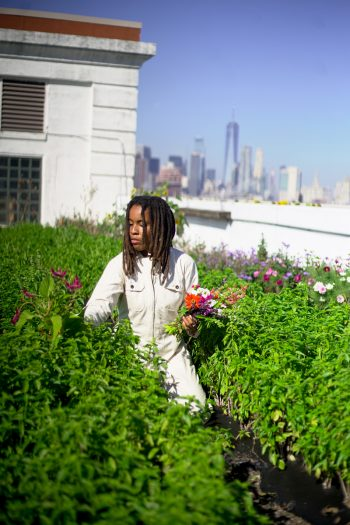 Amber Tamm Canty tending a rooftop garden. (Photo credit: Safiyah Chiniere / @safiyahchiniere