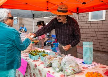 Joel Pelayo sells chiles at the Mercado del Valley. (Photo credit: Gorge Grown)