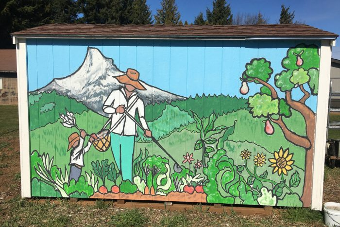 A mural of a Latinx farmer at Raices Cooperative Farm.