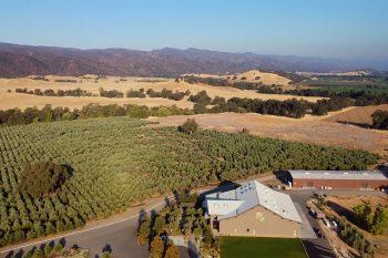 An overhead view of the Yocha Dehe Wintu Nation's farmland, including the Séka Hills oil processing mill.