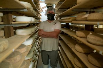 Pete Messmer in Lively Run's aged cheese room.