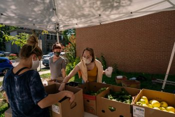A college student receives fresh produce at PressBay.
