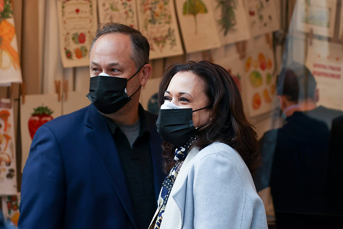 doug emhoff and kamala harris posing outside an event.