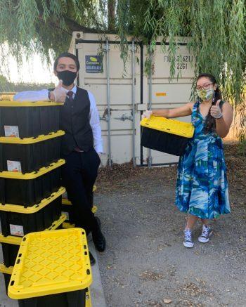 Preparing food boxes for distribution. (Photo credit: Urban Tilth)