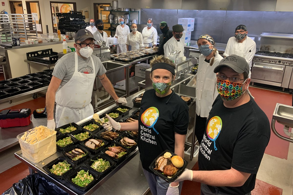 A team of students and chefs at Santa Fe Community College prepares a community meal. (Photo courtesy of Robert Egger)