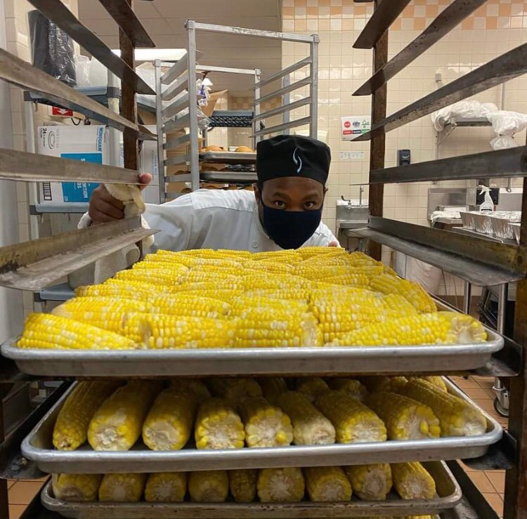 A culinary student at St. Paul College prepares corn for the community. (Photo courtesy of Robert Egger.)