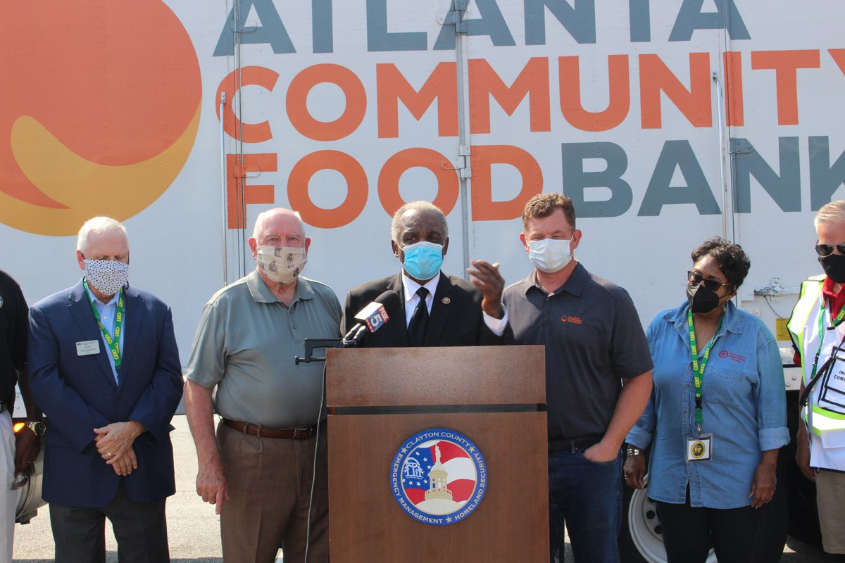 David Scott (center) with USDA Secretary Sonny Perdue at a food bank event in Georgia.
