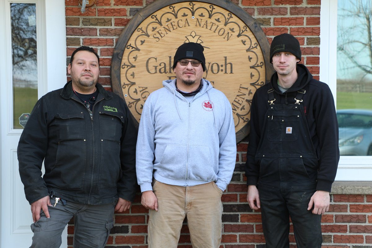 LeRoy Henhawk [left], Michael Snyder [center] and Allen Gage [right] stand together in supporting the Seneca Nation's food sovereignty efforts at Gakwi:yo:h Farms. (Photo courtesy of Seneca Media & Communications Center)