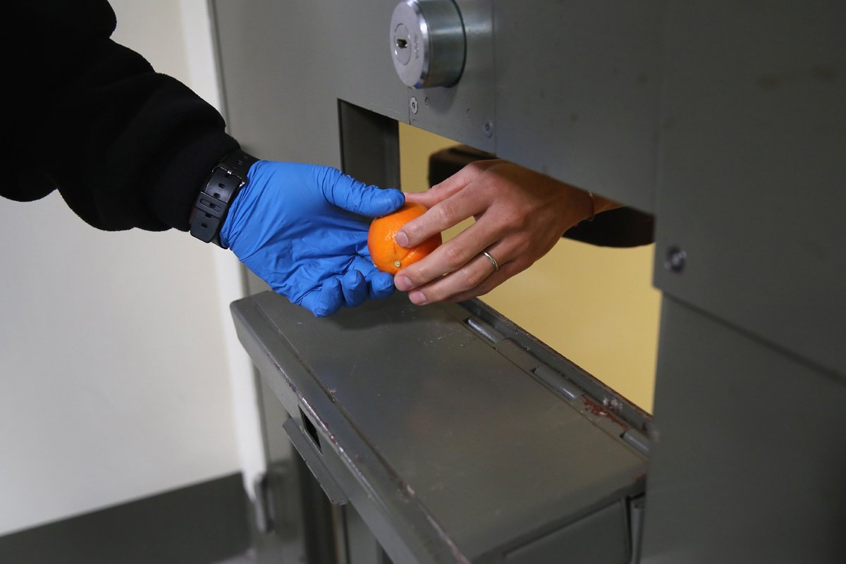 an inmate receives a fresh orange instead of unhealthy prison food