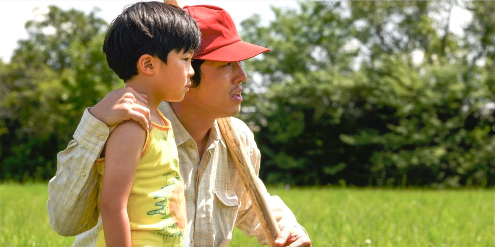 A still from the film Minari of a Korean American father and son. (Still courtesy of A24)