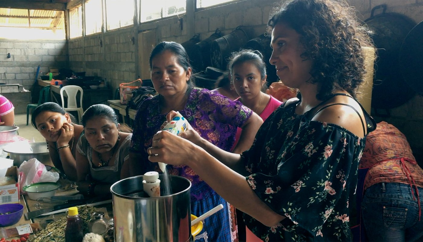 Karla McNeil-Rueda teaching Guatemalan women to prepare chocolate. (Photo credit: Madeline Weeks)