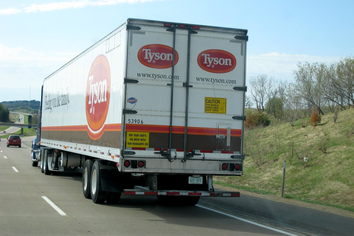 a tyson poultry truck delivers birds on the highway. Photo CC-licensed by Ed Kohler