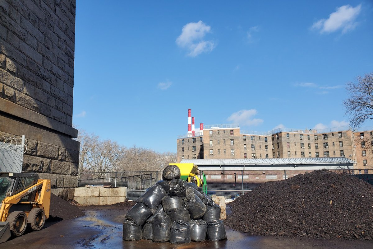 Big Reuse's compost site beneath the Queensboro Bridge. The Queensbridge Houses, the largest public housing development in the country, are in the backdrop.