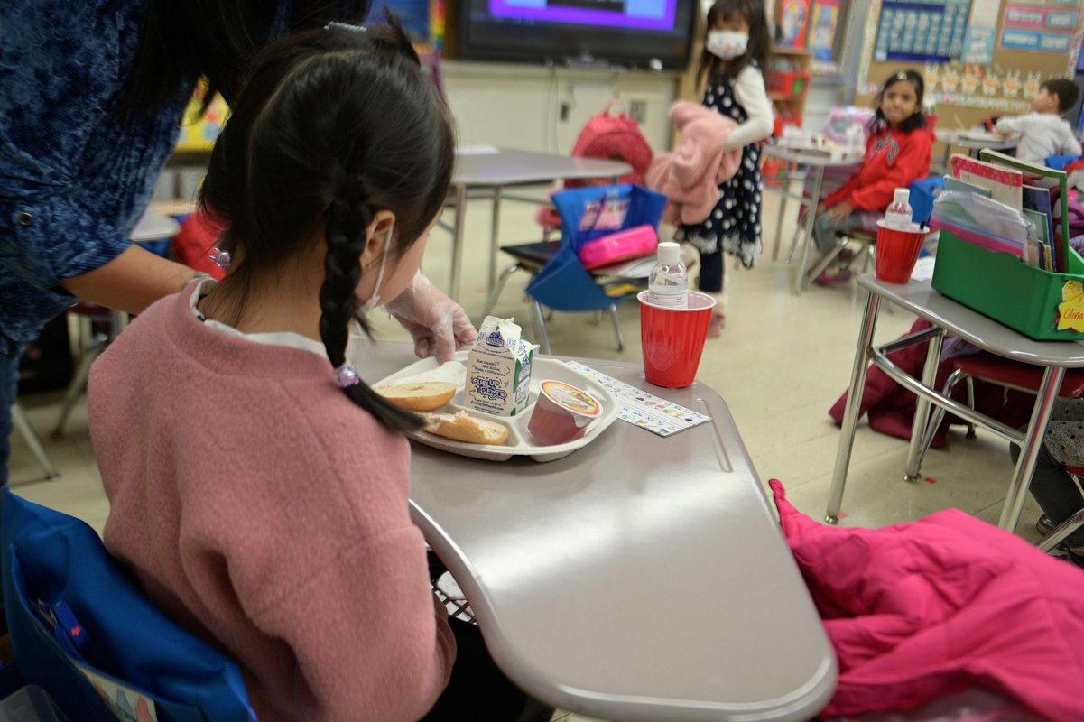 A kindergarten student eating breakfast at Yung Wing School P.S. 124 on January 13, 2021 in New York City.
