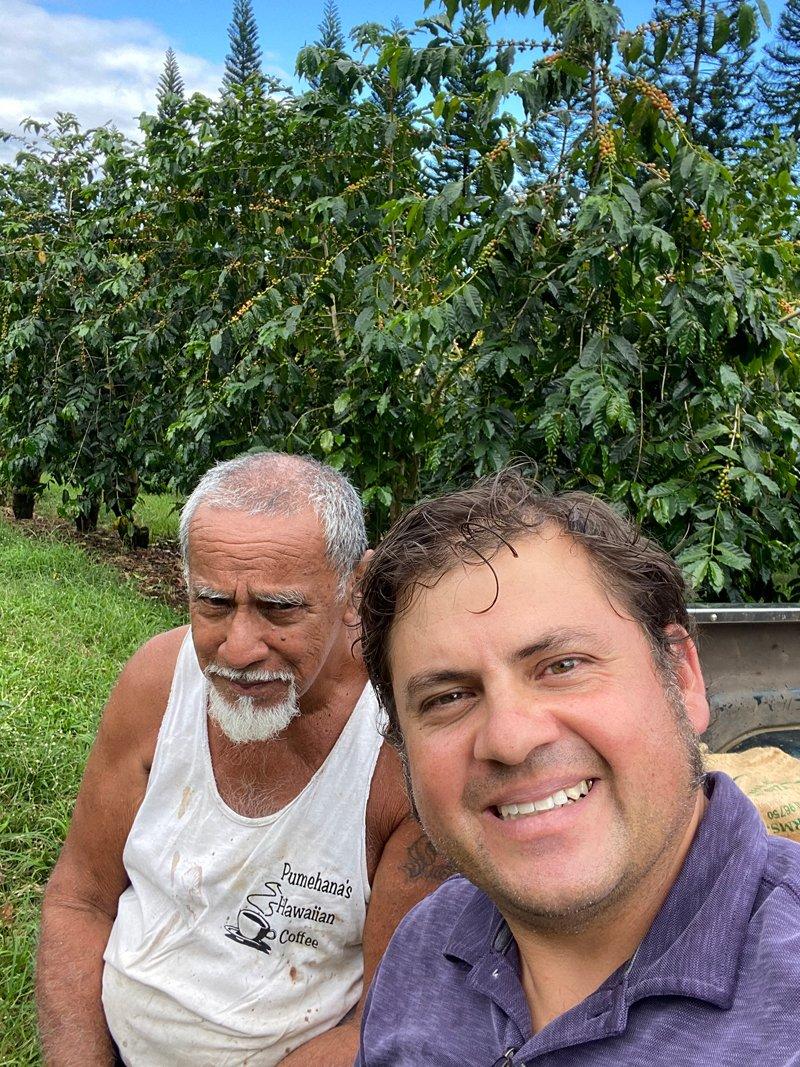 Arturo Ballar (right), with a Kona coffee farmer. (Photo credit: Arturo Ballar)