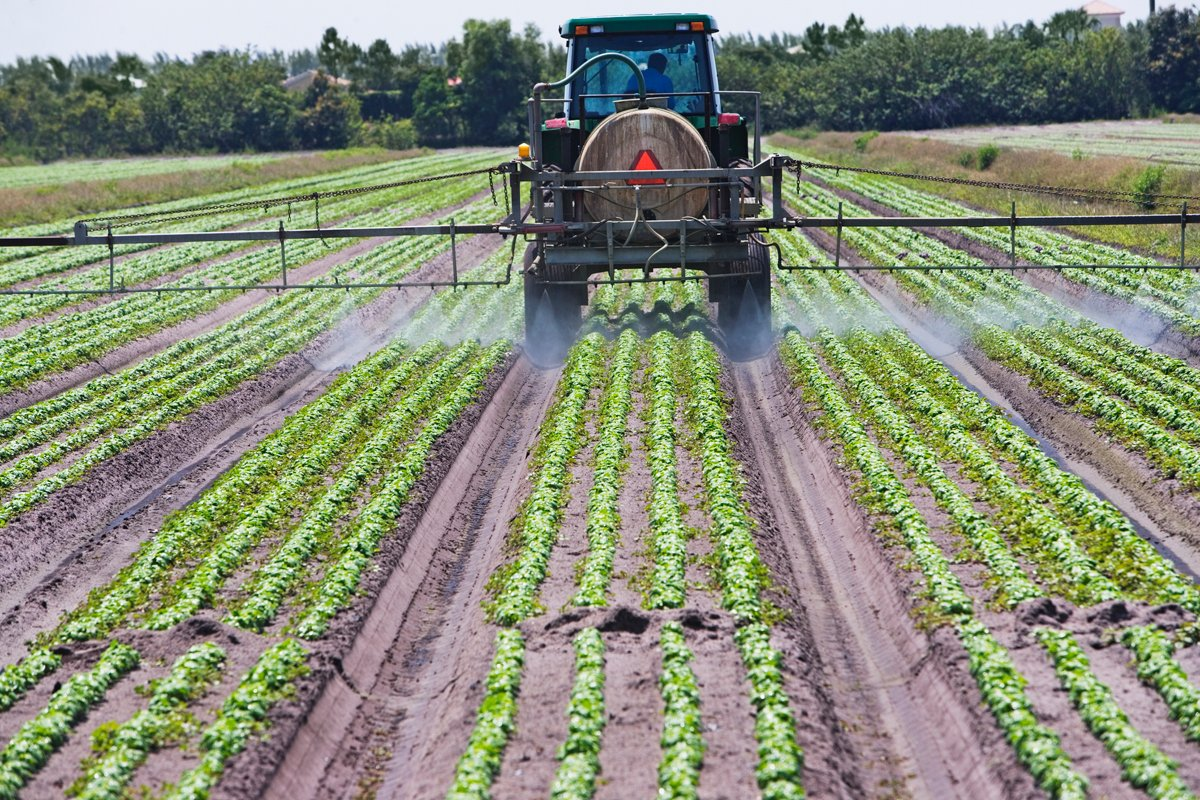 A tractor spraying nitrogen based fertilizer on farm fields