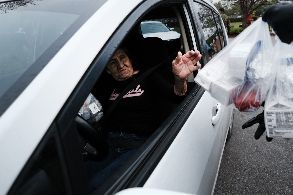 Food is distributed during a mobile food pantry in the agricultural community of Immokalee on February 16, 2021 in Immokalee, Florida.