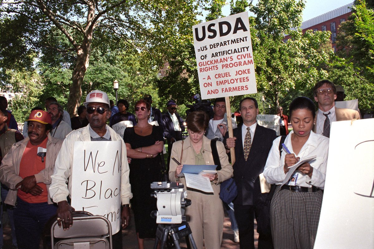Black farmers protest at Lafayette Park across from the White House in Washington, D.C. on September 22, 1997. Protesters alleged the U.S. Department of Agriculture (USDA) denied black farmers equal access to farm loans and assistance based on their race. North Carolina farmer Timothy Pigford and 400 other black farmers filed the Pigford v. Glickman (Pigford I) class-action lawsuit against USDA in 1997. The USDA settled Pigford I in 1999. USDA photo by Anson Eaglin.