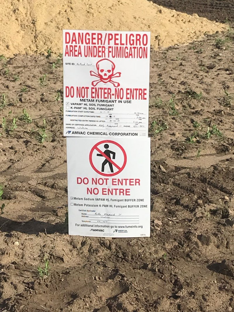 a sign warning of danger from pesticide poisoning. (Photo credit: Mike Tauber)
