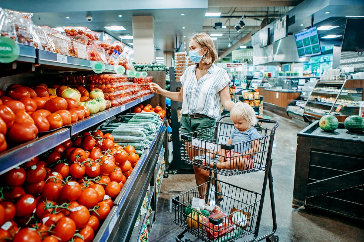 a woman and child shop for groceries using wic and snap at the supermarket during the pandemic