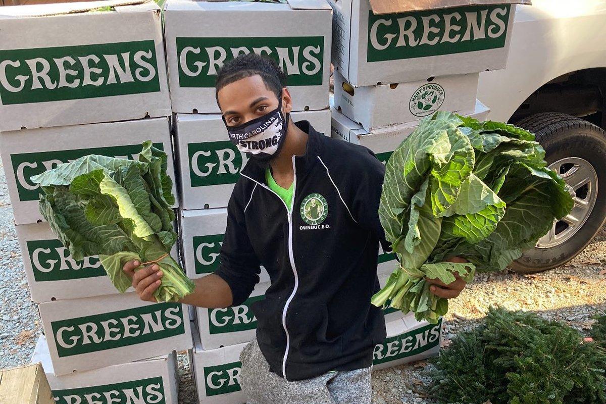 Donovan Watson holds collard greens at Perkins Orchard. Perkins Orchard. (Photo courtesy of Donovan Watson)