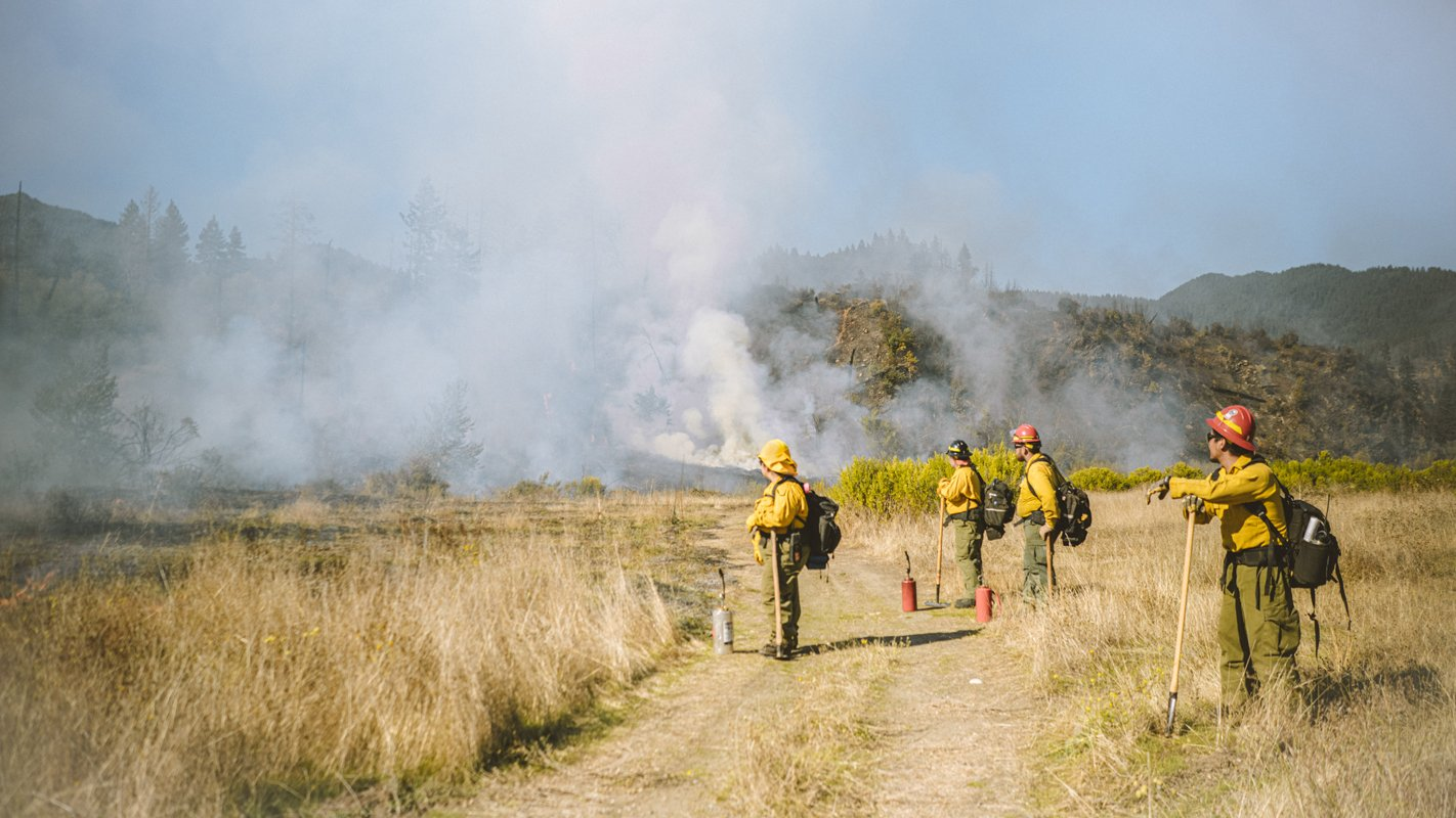 A prescribed burn by the Karuk Tribe. (Photo credit: Costa Boutsikaris)