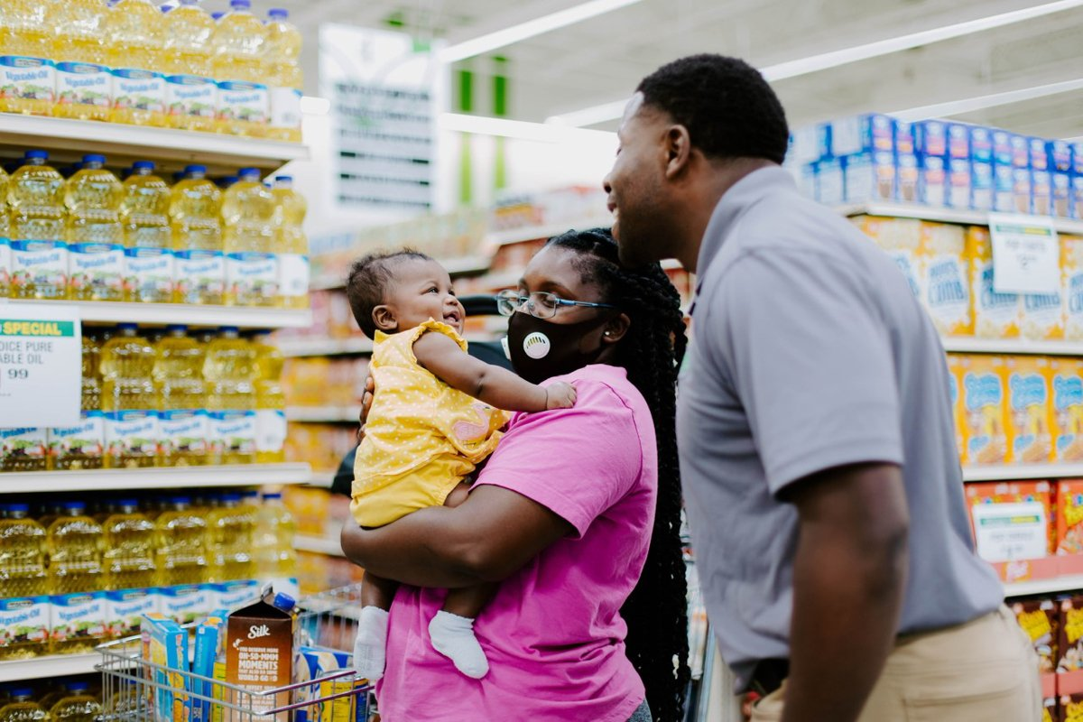 a Black family shops at the Oasis Market in North Tulsa.