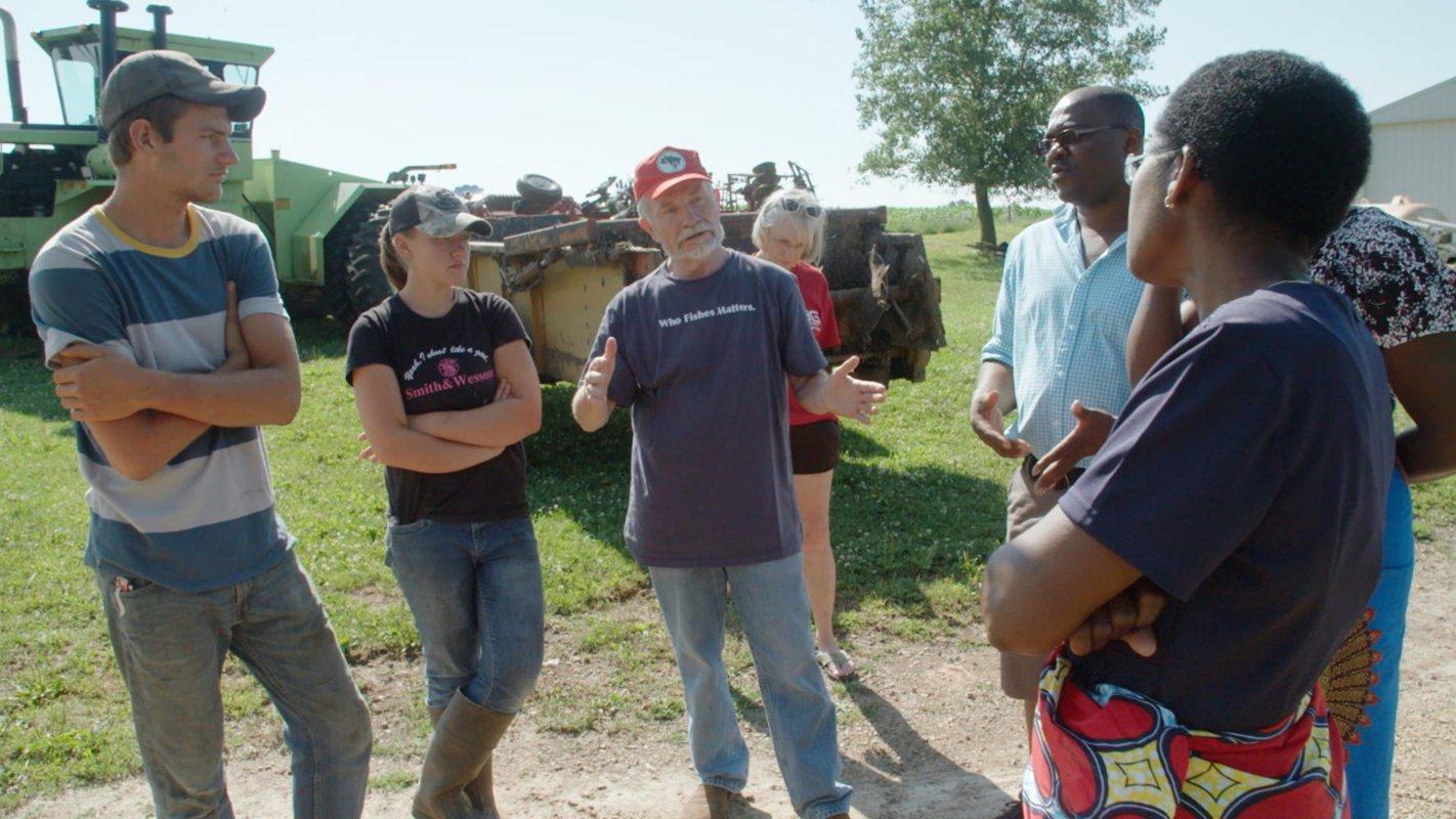From left, Jordan Jamison, Liz Badger, Jim Goodman, Rebecca Goodman, Peter Mazunda and Esther Lupafya discuss climate change on the Goodman family dairy in Wonewoc, Wisconsin.