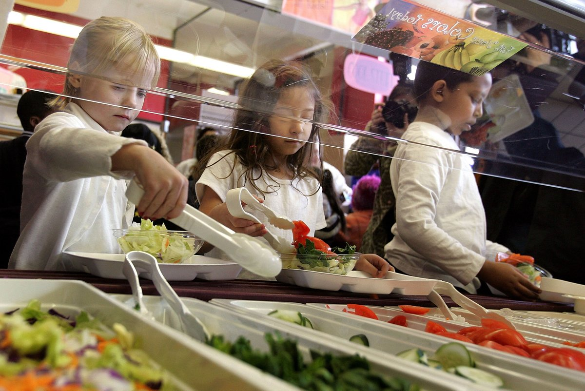 students get a healthy salad for a school meal