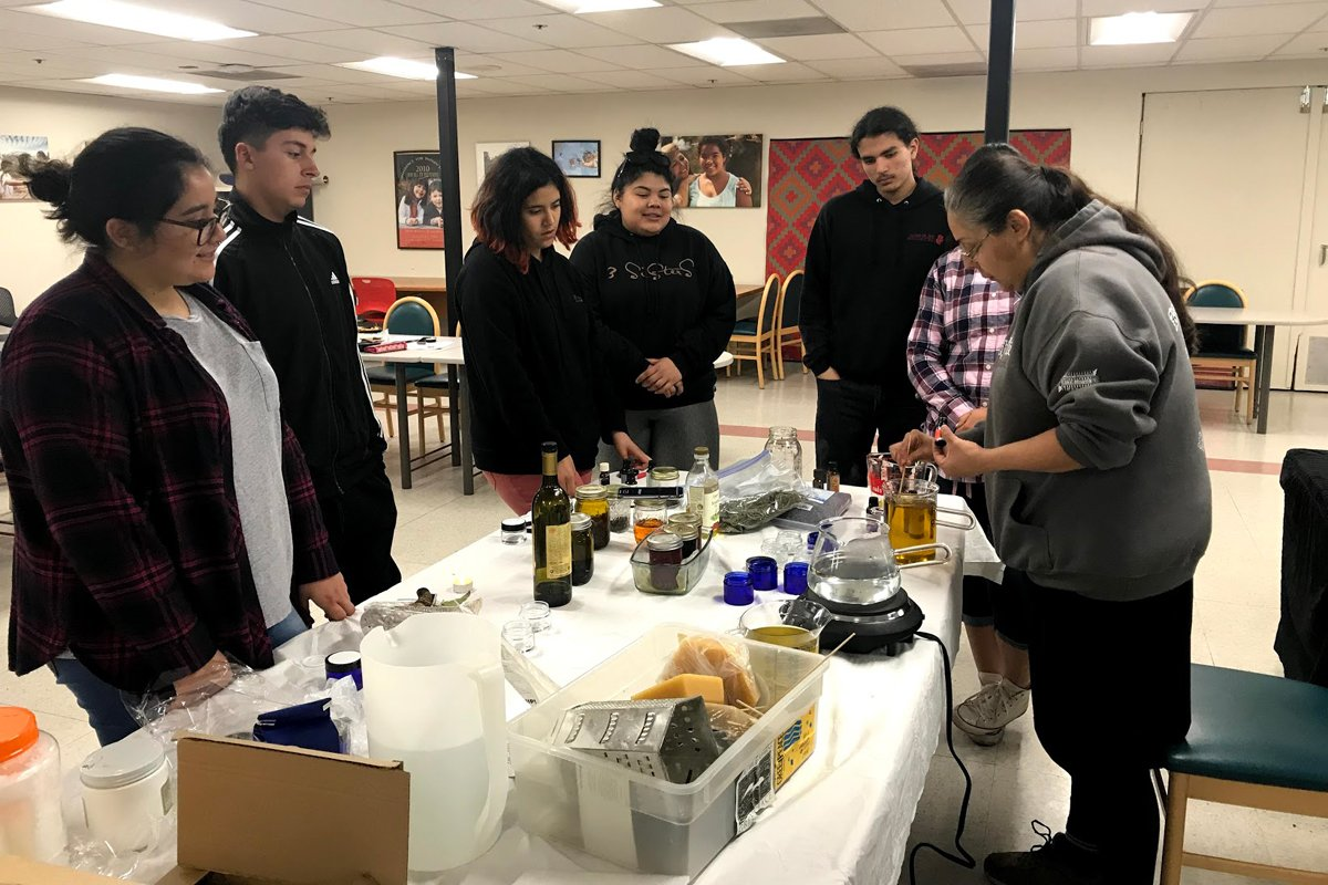 A group of Native youth participate in a cooking class hosted by the CIMCC, in a photo taken prior to the pandemic.