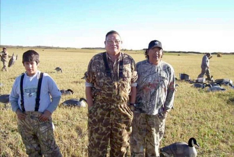 Ruth Hopkins' father, hunting with his nephews. (Photo courtesy of Ruth Hopkins)